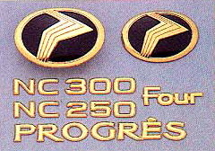 Gold emblem (model symbol mark) (car name logograph (for rear))(Grademark (for rear) NC250/NC300) (Four) (model symbol mark (for rear))