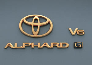 Gold emblem (the Toyota symbol (for rear)) (Car name logograph (for rear)) (Aerodynamic volume displacement mark (V6))
