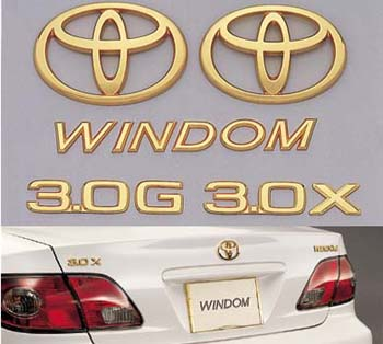 Gold emblem (the Toyota symbol [for front for rear]/car name logograph [for rear]/grademark [for rear])