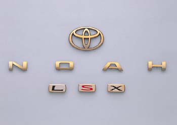 Gold emblem (the Toyota symbol (for rear), car name logograph (for rear), grademark (L S X))