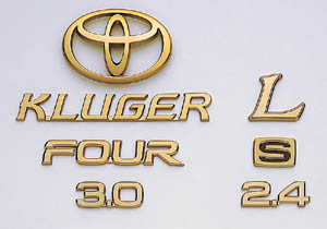 Gold emblem (car name logograph (for rear)) (Aerodynamic volume displacement mark) (rear drive) (the Toyota symbol (for rear))