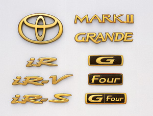Gold emblem (the Toyota symbol (for rear)) (Car name logograph (for rear) MARK?) [grademark (for rear)] (G) (IR−V) (IR−S) (IR) (GRANDE) [Rear drive] (G−FOUR) (FOUR)